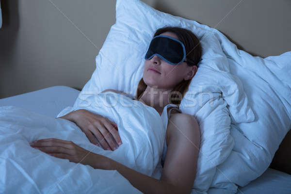 Woman Sleeping In Bed With Eye Mask Stock photo © AndreyPopov
