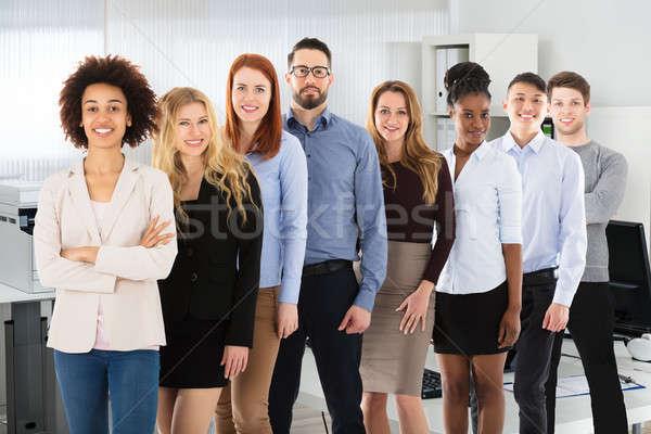 Többnemzetiségű üzletemberek iroda mosolyog fiatal mosoly Stock fotó © AndreyPopov