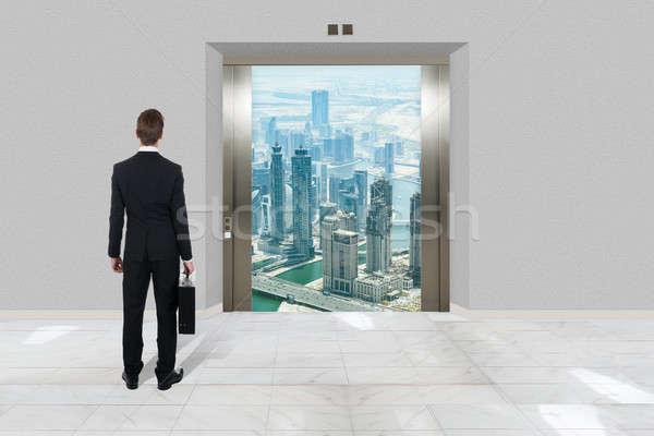 бизнесмен портфель глядя современных лифта вид сзади Сток-фото © AndreyPopov