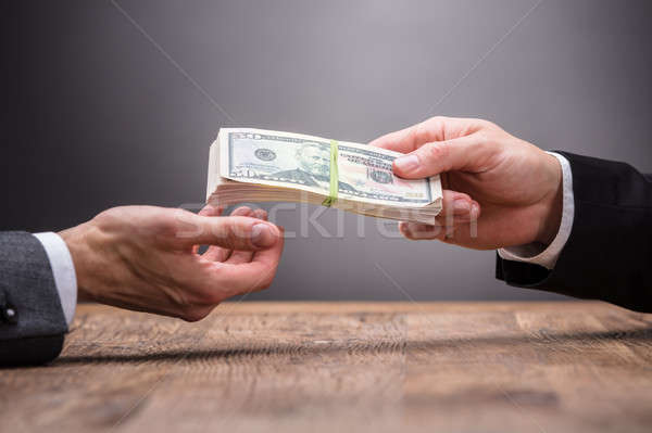 Businessperson Taking Bribe In Office Stock photo © AndreyPopov