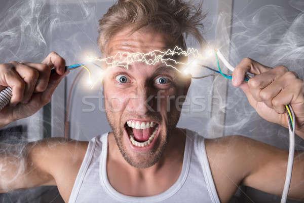 Férfi tart drótok portré sikít fájdalom Stock fotó © AndreyPopov