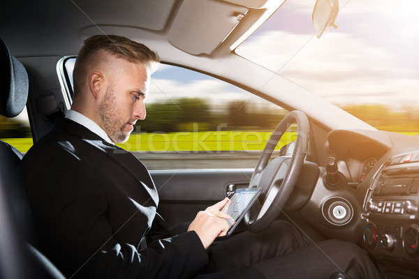 Businessman Sitting Inside Self Driving Car Stock photo © AndreyPopov