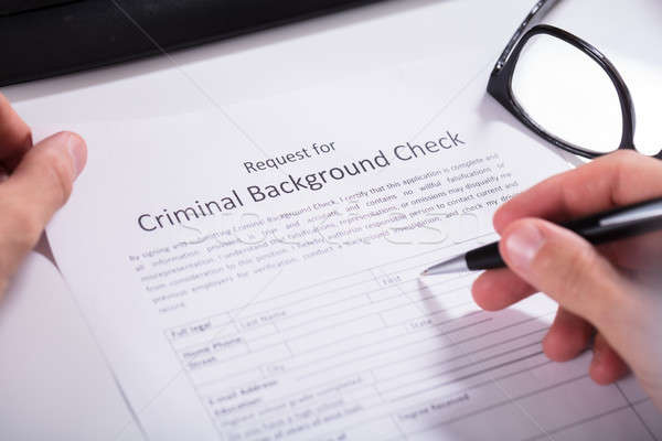 Person Hand Filling Criminal Background Check Application Form Stock photo © AndreyPopov