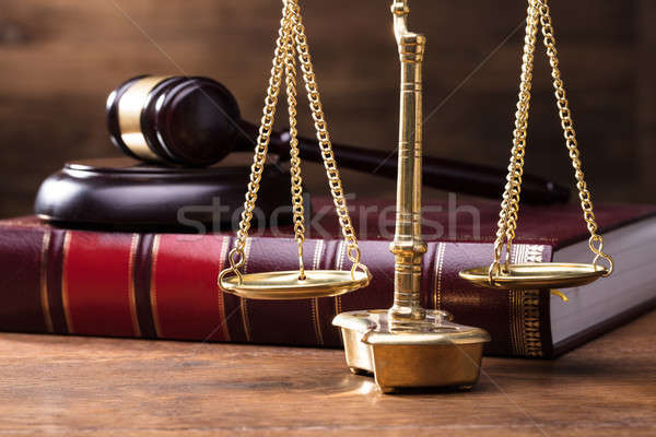 Judge Golden Scale In Front Of Gavel And Law Book Stock photo © AndreyPopov