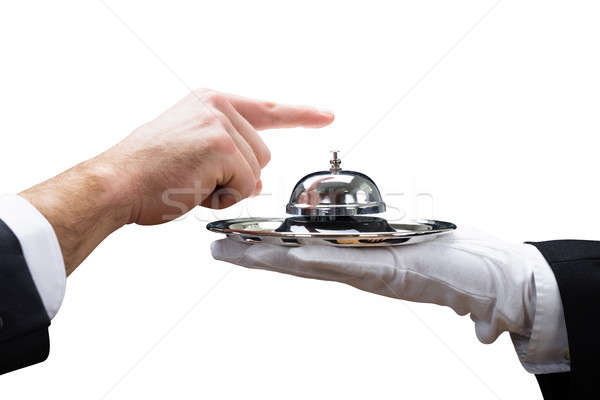Customer Ringing Service Bell Held By Waiter Stock photo © AndreyPopov