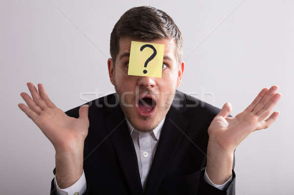 Businessman With Question Mark Sticky Note On His Forehead Stock photo © AndreyPopov