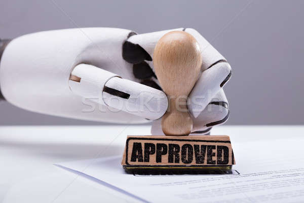 Robot Hand Approving Document Stock photo © AndreyPopov