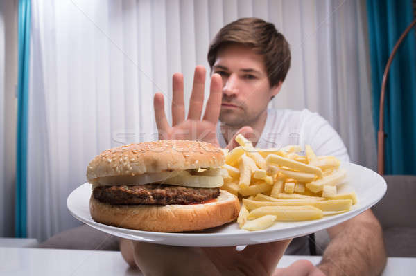 Man Refusing Unhealthy Food Stock photo © AndreyPopov