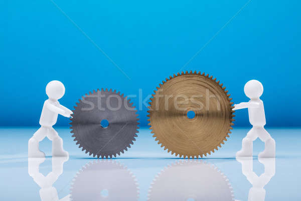 Two Human Figures Holding Cogwheels Stock photo © AndreyPopov