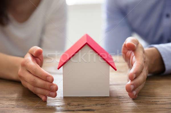 Couple Protecting House Model Stock photo © AndreyPopov
