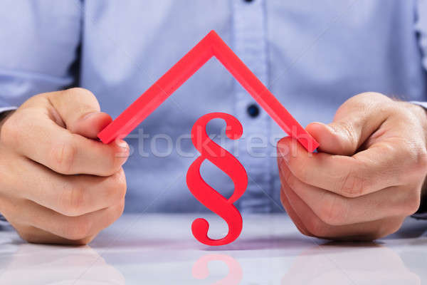 Human Hand Holding Roof Over Paragraph Symbol Stock photo © AndreyPopov