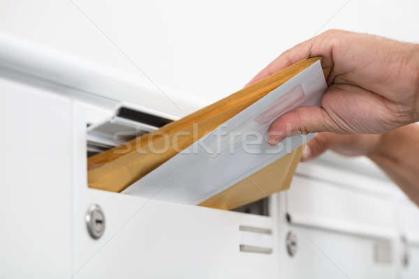 Man taking letters from mailbox Stock photo © AndreyPopov