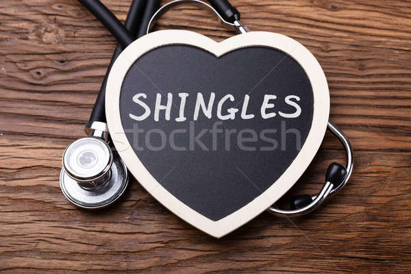 Elevated View Of Stethoscope And Heart With Word Shingles Stock photo © AndreyPopov