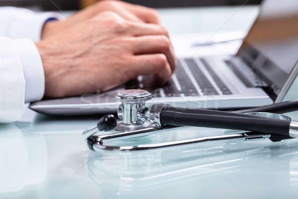 Stock photo: Doctor Using Laptop