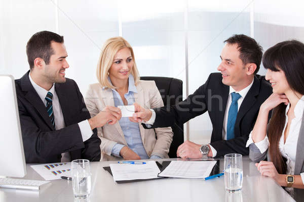 Two Businessman Exchanging Visiting Card Stock photo © AndreyPopov