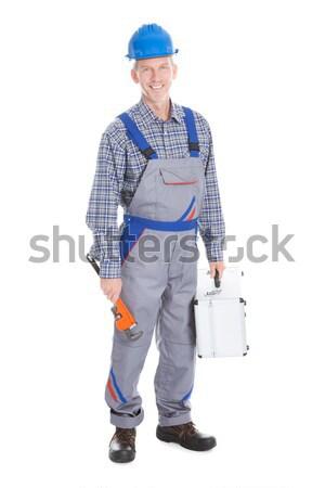 Retrato jóvenes trabajador de la construcción feliz masculina pie Foto stock © AndreyPopov