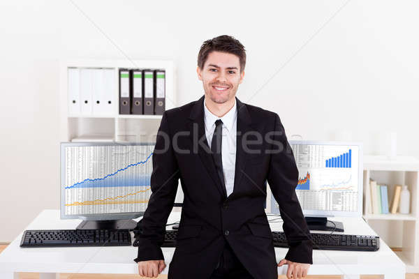 Stock photo: Confident smiling stock broker
