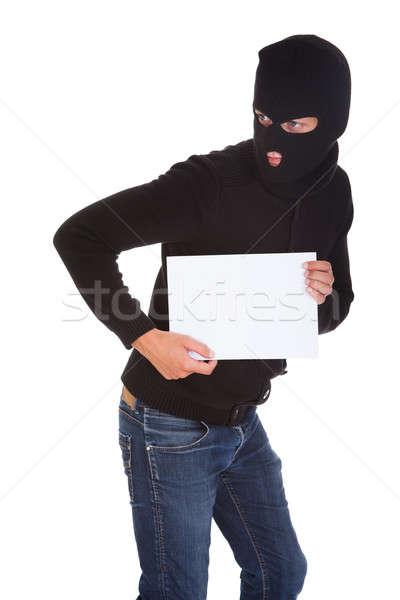 Burglar Holding Blank Placard Stock photo © AndreyPopov