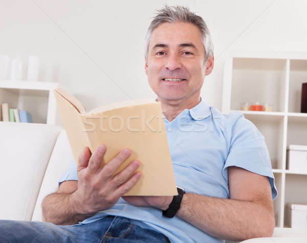 Mature Man Reading Book Stock photo © AndreyPopov