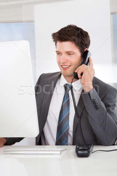 Businessman talking on the telephone Stock photo © AndreyPopov