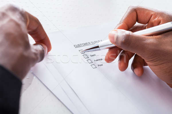 Close-up Of Hand Filling Form Stock photo © AndreyPopov