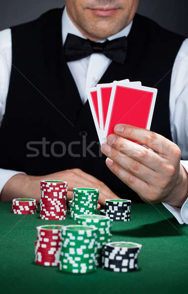 Croupier holding playing cards Stock photo © AndreyPopov