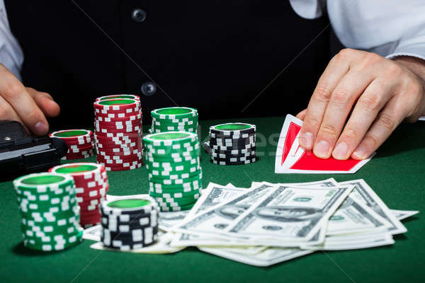 Portrait of a croupier looking at playing cards Stock photo © AndreyPopov