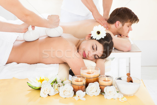 Couple Receiving Back Massage In Spa Stock photo © AndreyPopov