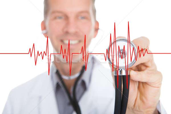 Orvos hallgat szívdobbanás sztetoszkóp boldog átlátszó Stock fotó © AndreyPopov