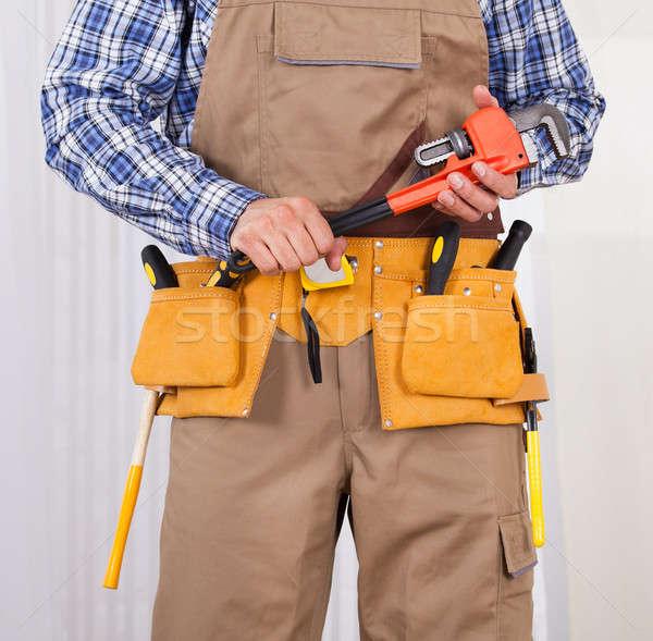 Repairman Holding Adjustable Wrench Stock photo © AndreyPopov
