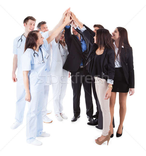 Doctors and managers making high five gesture Stock photo © AndreyPopov