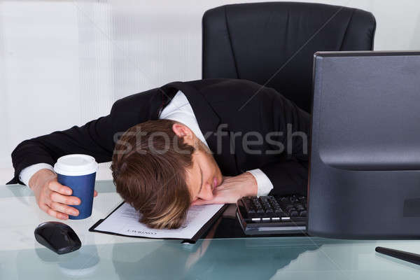 Overworked Businessman Resting On Contract Paper Stock photo © AndreyPopov