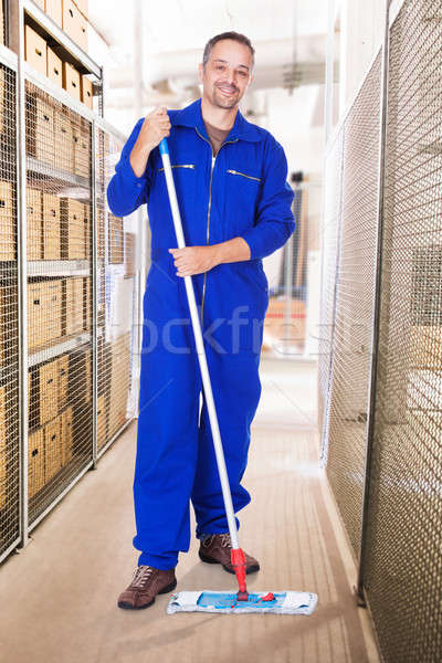 Smiling Worker Cleaning Warehouse With Mop Stock photo © AndreyPopov