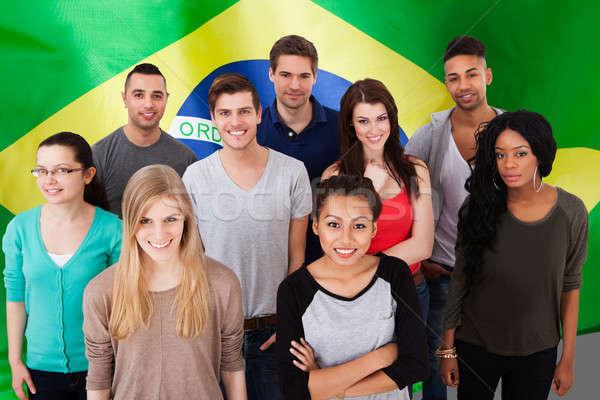 Boldog több nemzetiségű csoportkép áll Brazília zászló Stock fotó © AndreyPopov
