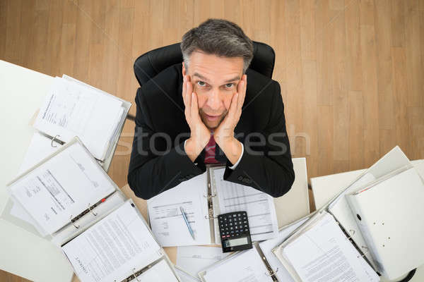 Worried Businessman With Hands On Cheek Stock photo © AndreyPopov
