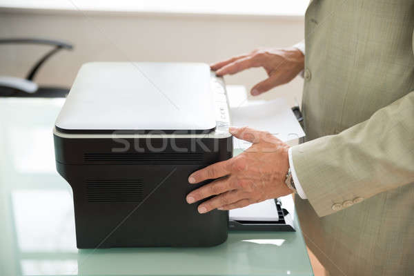 Businessman Using Scanner Stock photo © AndreyPopov