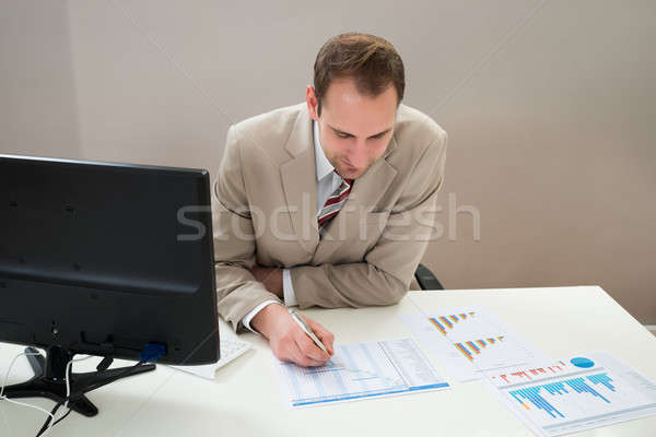 Businessman Making Gantt Diagram In Office Stock photo © AndreyPopov