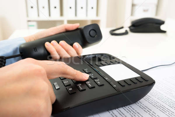 Businessperson Dialing Number On Telephone Keypad Stock photo © AndreyPopov