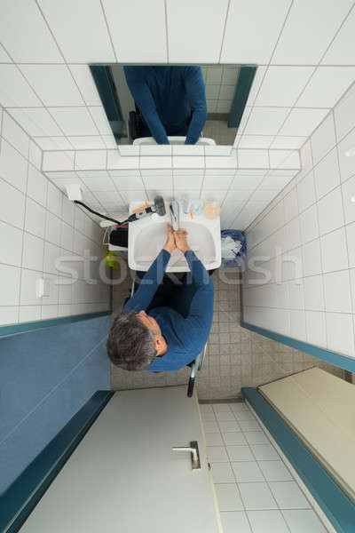 Disabled Man In Bathroom Washing Hands Stock photo © AndreyPopov