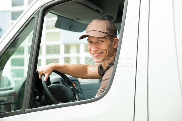 Delivery Man Driving Van Stock photo © AndreyPopov