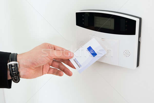 Stock photo: Businessperson Hands Holding Keycard