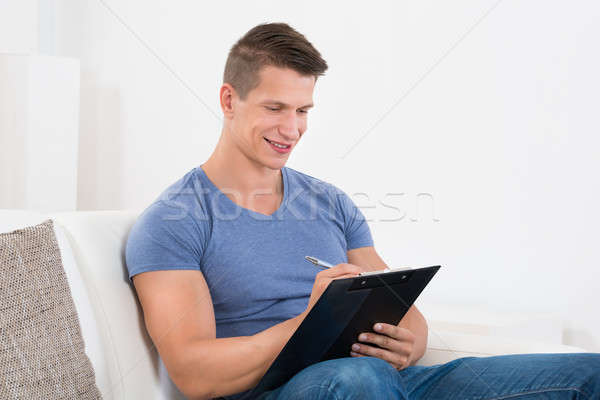 Mutlu adam genç yazı oturma Stok fotoğraf © AndreyPopov