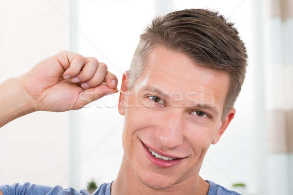 Man Cleaning His Ear Stock photo © AndreyPopov