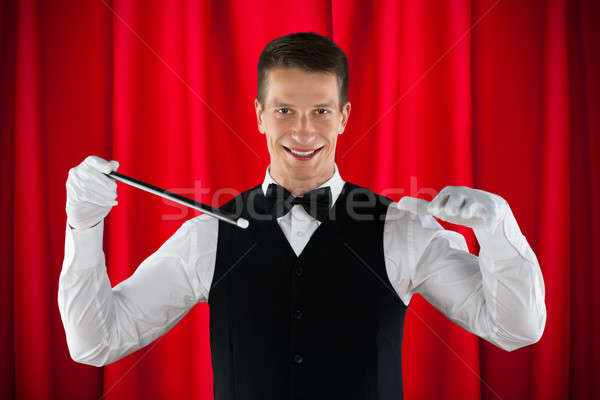 Male Magician Performing Magic Stock photo © AndreyPopov