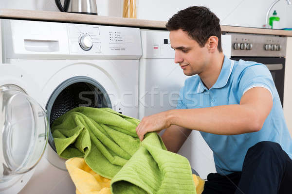 Man Loading Towels In Washing Machine Stock photo © AndreyPopov