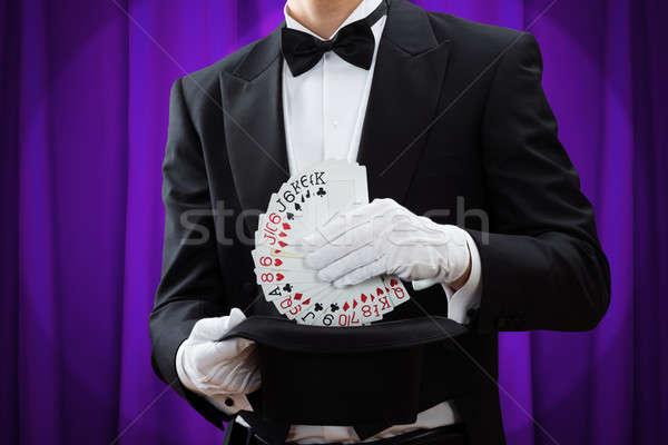 Bűvész kártyapakli kalap férfi lila függöny Stock fotó © AndreyPopov