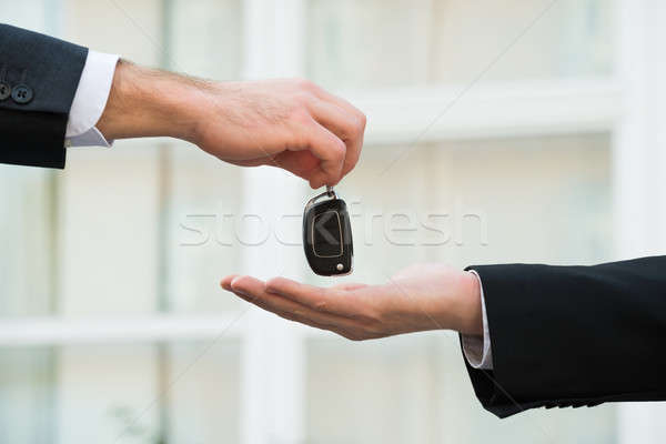 Car Dealer Giving Keys To Businessman Stock photo © AndreyPopov