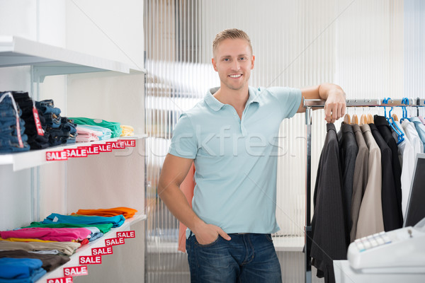 Vendeur rack vêtements magasin portrait Photo stock © AndreyPopov