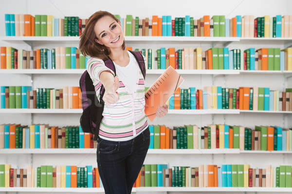 Happy University Student Showing Thumbsup At Library Stock photo © AndreyPopov