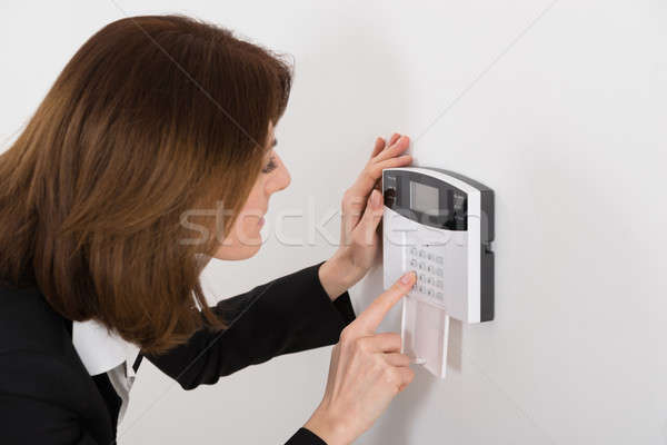 Woman Entering Code In Security System Stock photo © AndreyPopov